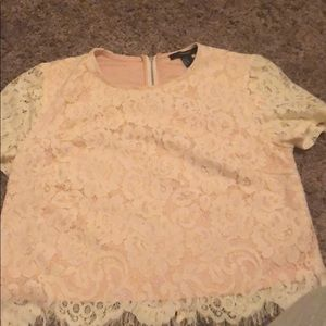 Pink shirt with white lace underneath